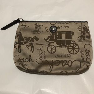 Coach embroidered wristlet NWT